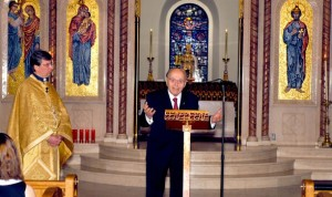 Arthur C. Anton speaks at Annunciation Cathedral in Boston. Next to him Fr. Cleopas Strongilis.