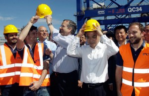 Greek Prime Minister Antonis Samaras (3 L) and the Chinese Premier Li Keqiang (2R) talk with port workers during their visit in Cosco containers terminal at Piraeus port, Athens, Greece, 20 June 2014. EPA/Orestis Panagiotou