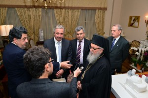 Archbishop Demetrios of America and Greek Minister of Energy Yiannis Maniatis spek to the press following their meeting at the headquarters of the Greek Orthodox Archdiocese. Photo: Dimitrios Panagos