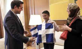 Tsipras hosts Afghan boy, 11, whose  home was targeted by racist vandals