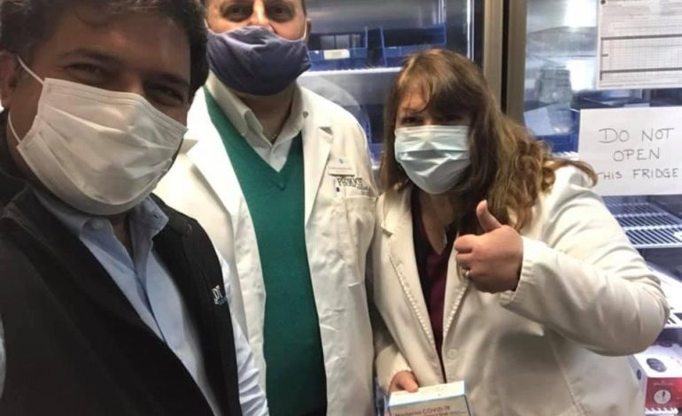 """Dr. John Grossomanides, a pharmacist and past AHEPA Supreme President """"assisting"""" Santa in distributing Covid-19 Vaccines"""